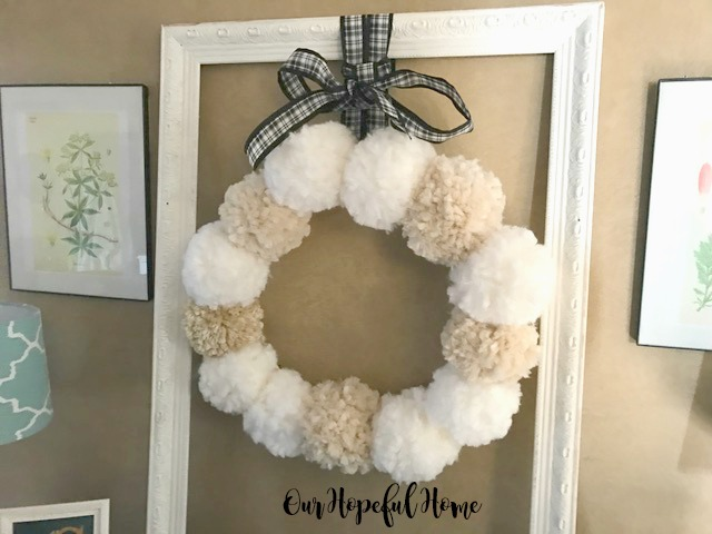 DIY yarn pom pom wreath Christmas Anthro-inspired