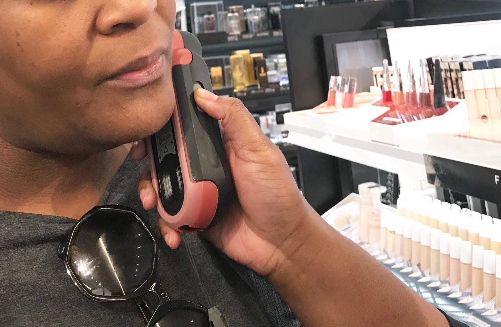 Image Fenty representative doing a skin test before suggesting makeup color