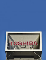 "Toshiba's dramatic exit from the business of building nuclear power plants lands another blow to a beleaguered sector, undermining new development and research on advanced reactor designs.  After acquiring a majority stake in Pittsburgh-based Westinghouse Electric in 2006 for $5.4 billion, the Tokyo technology conglomerate had high hopes for rolling out a new generation of safer, smaller, cheaper power plants, as well as a series of streamlined full-scale reactors. Four of the latter are under construction in the United States, representing the only new reactors currently being built in the country. But the company was bedeviled by cost overruns, technical problems, conflicts with contractors, and regulatory challenges that set those projects back by years.  On Tuesday, Toshiba projected a $6.3 billion write-down for its nuclear unit and said it was looking to unload its stake. ""It looked like a big deal at the time, but it's turned into a mess,"" says Michael Golay, a professor of nuclear science and engineering at MIT. ""And it's likely to have a very chilling effect.""  Toshiba's four massive nuclear plants now under construction in the southern United States are AP1000 pressurized-water reactors, which use a simplified design that was supposed to accelerate construction. But the Vogtle project in Georgia and the V.C. Summer project in South Carolina are both around three years behind schedule and, together, billions of dollars over budget.  The company said those projects will continue, but many energy experts believe Toshiba's decision to cease building new reactors spells the end of any nuclear construction in the United States for the foreseeable future. Analysts doubt Toshiba will find a buyer for its Westinghouse stake, or any willing construction partners to move ahead with dozens of additional plants it had once planned.  Toshiba's struggles reflect the slow demise of nuclear power in much of the world (see ""Giant Holes in the Ground""). The industry has been plagued by the rising cost of construction, the low price of natural gas, the Fukushima disaster in 2011, and the stricter regulations and souring public perceptions that followed. Germany is scaling down its nuclear program, engineering powerhouses like GE and Siemens have pulled back from the market, and France recently engineered the takeover of the nuclear giant Areva to rescue it after a series of stumbles.  Many fear the slowdown will prevent nations from building enough capacity to avoid the growing risks of climate change. The International Energy Agency estimates that nuclear energy capacity needs to double by 2050 to keep worldwide temperatures from rising more than 2 °C. Absent a carbon-capture breakthrough or a miracle battery, there's no realistic plan for cutting greenhouse-gas emissions fast enough without far more use of nuclear, says Steven Chu, the former secretary of energy and a professor of physics at Stanford.  There is, however, something of a nuclear power renaissance under way in some parts of the world, including South Korea, Russia, India, and China. Worldwide, about 60 reactors are under construction and 160 are planned—enough to add almost half again today's capacity, according to the World Nuclear Association. China alone is building dozens of conventional nuclear plants and forging ahead with advanced reactor designs in hopes of becoming the world's leader in nuclear power."