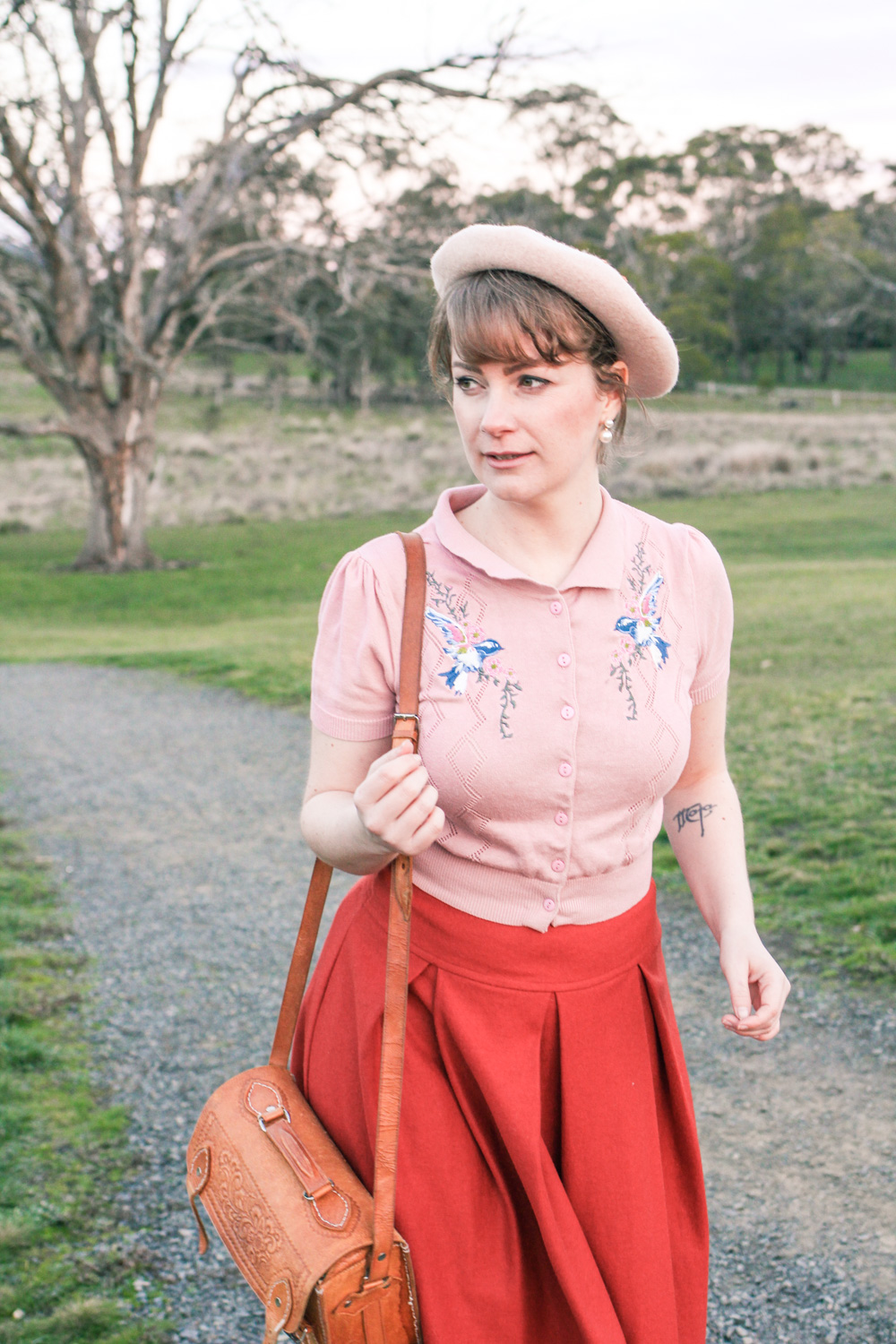@findingfemme wears pink embroidered cardigan and beret