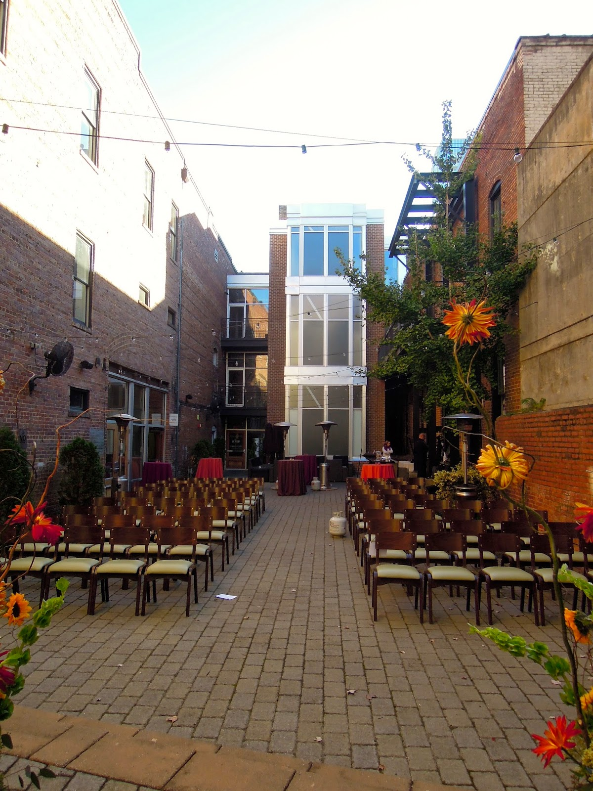 The View From Stage Area To Rear Of Courtyard Where Entrances Sitti And Gravy Are On Right