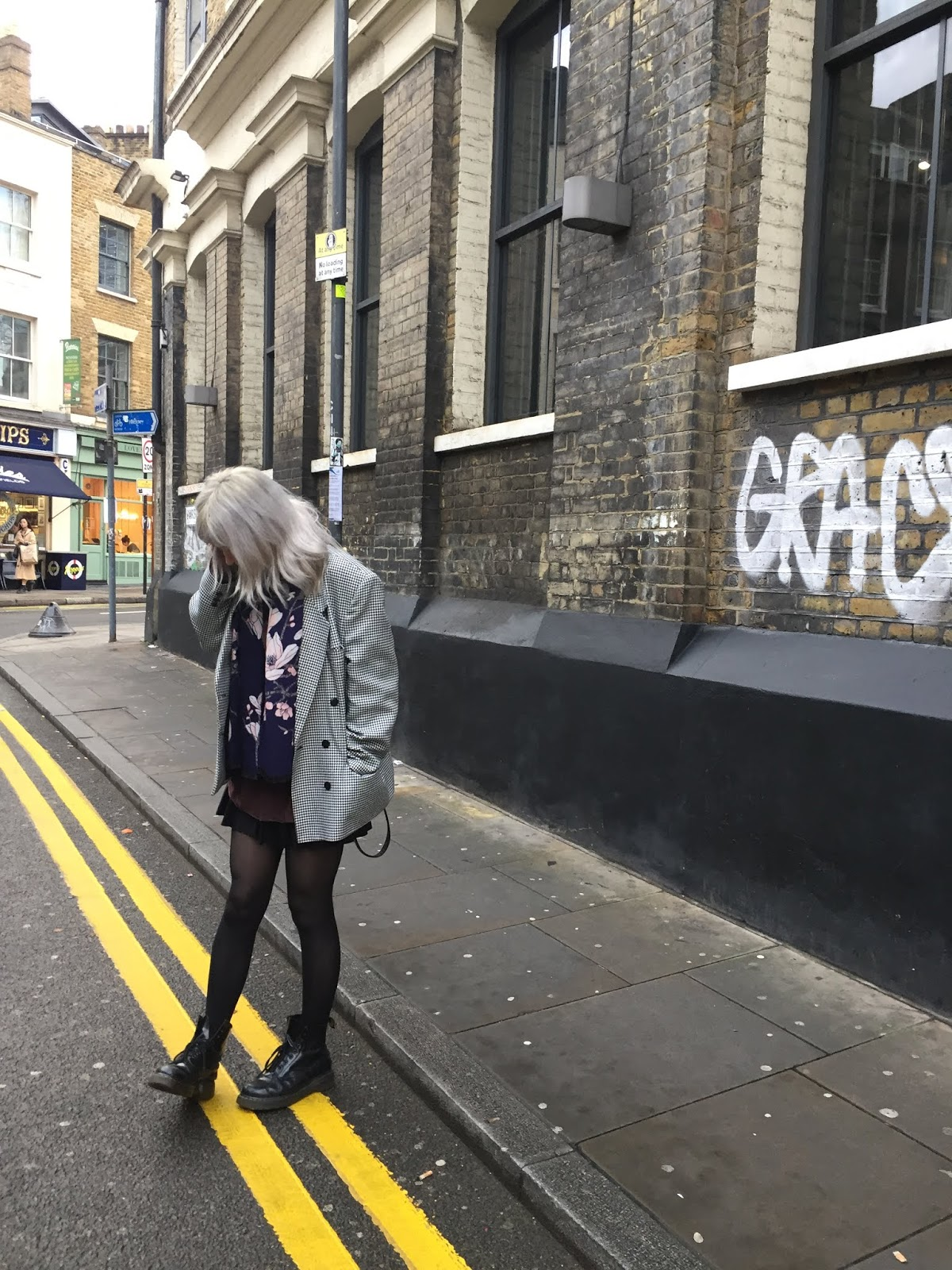 silver haired girl wearing blazer, doc martens and a big scarf in East London
