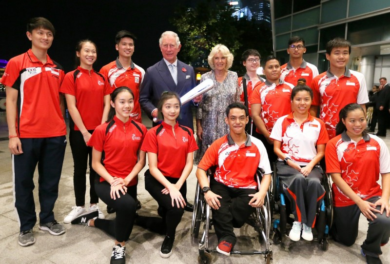 After arriving, Charles, wearing a suit in the tropical heat, and Camilla met Singapore athletes who were taking part in the Queen's Baton Relay, which travels around the world ahead of the Gold Coast 2018 Commonwealth Games.