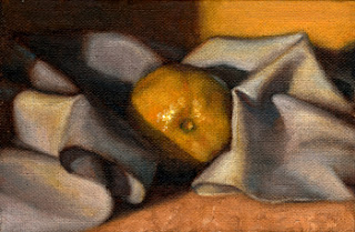 Oil painting of a lemon nestled amongst the folds of a tea towel.