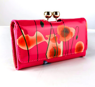Patent leather clutchbag with butterfly floral design