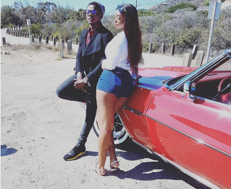 """Fans go gaga as Kiss Daniel is pictured with heavy """"ukwu"""" lady"""