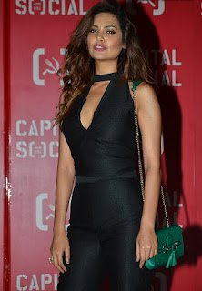 Esha Gupta looks confident and glamorous in black sleeveless top and trousers