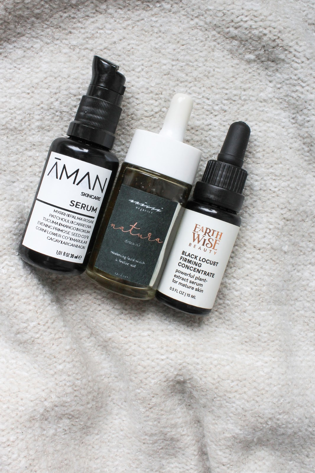 Organic, natural, cruelty free facial oils. Earthwise Beauty Black Locust Firming Concentrate, Emanufaktur Aman Skincare Serum, Nini Organics Natura Detox Oil