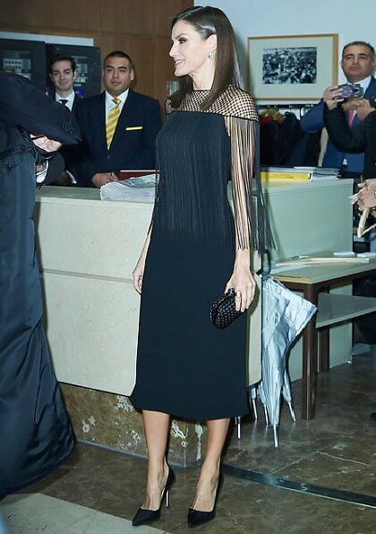 Queen Letiza in Carolina Herrera wool coat and Carolina Herrera lace fringed dress, Bottega Veneta clutch. Magrit pumps