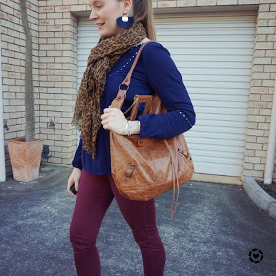 awayfromblue instagram navy blouse with leopard print scarf and burgundy skinny pants outfit