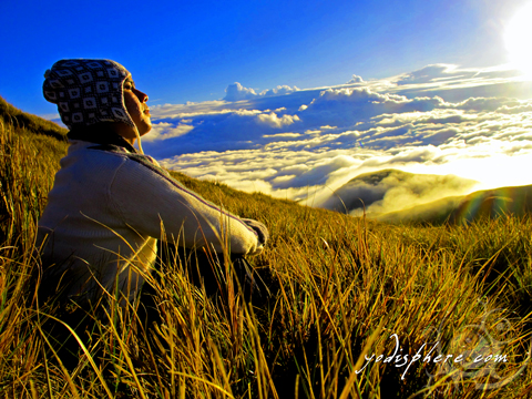 The Thinker: Man contemplating at Mt. Pulag peak looking at the sea of clouds