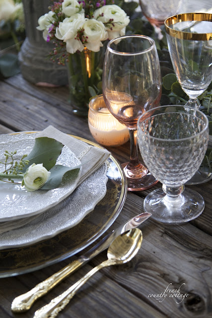 Table setting close up with flowers and wine stems