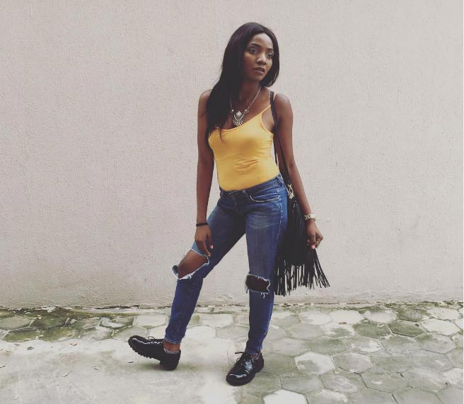 This ripped jeans of singer Simi though...