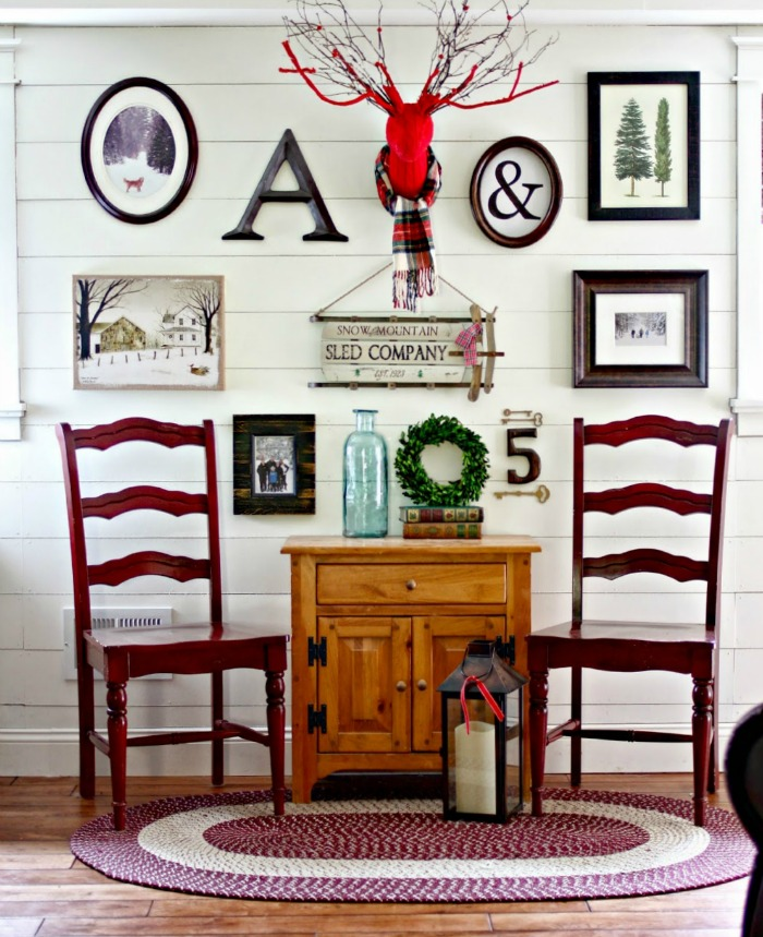 Gallery wall with a winter theme on a planked shiplap wall - www.goldenboysandme.com