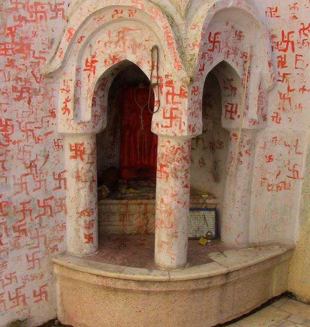 Swastikas inscribed at a Kshetrapala shrine at Hanumantal Bada Jain Mandir at Jabalpur
