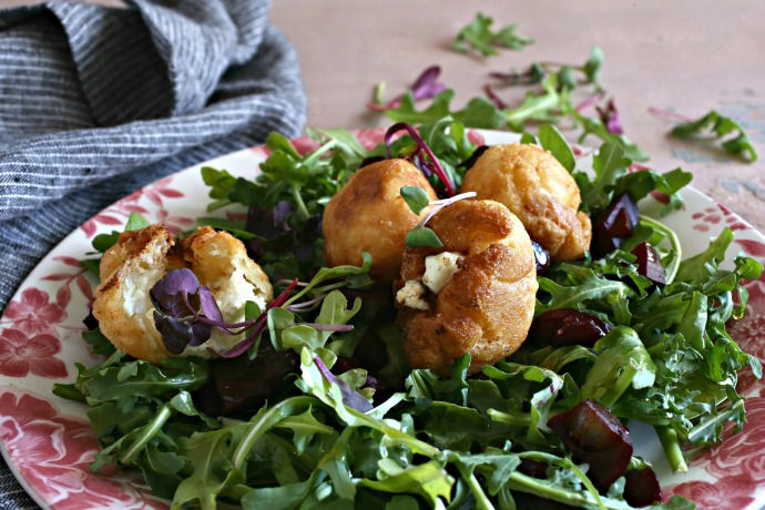 Crispy goat cheese filled dough puffs served over salad.