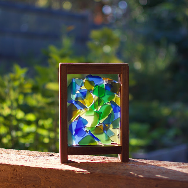 Freestanding kaleidoscope suncatcher, perfect for a sunny windowsill.