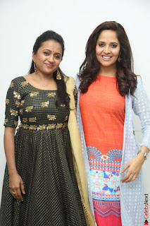 Actress Suma in Black Salwar Suit and Anusuya in orange Dress at winner movie press meet part 1 February 2017.jpg