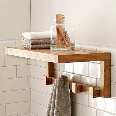 fabulous shelf on bathroom counter | ENTIRELY DESIGN: Teak is fabulous in a bathroom.