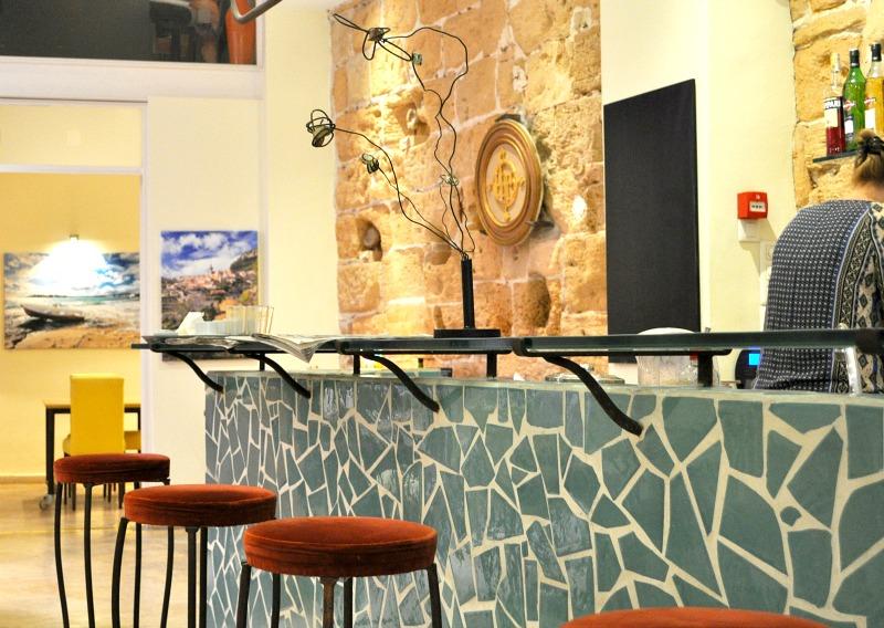 Cool Mosaic bar and iron stools