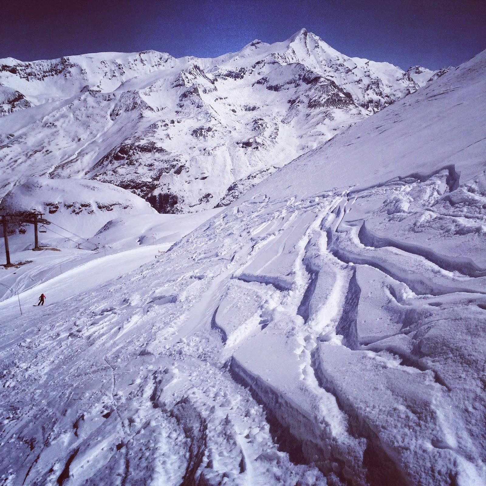 Snow skiing sun shining tracks