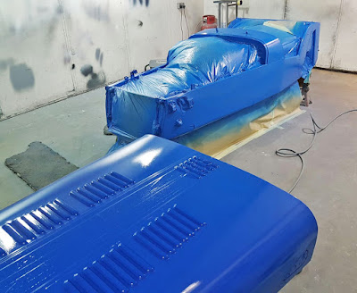 Three coats of Z12 Porsche Voodoo Blue were sprayed in light coats