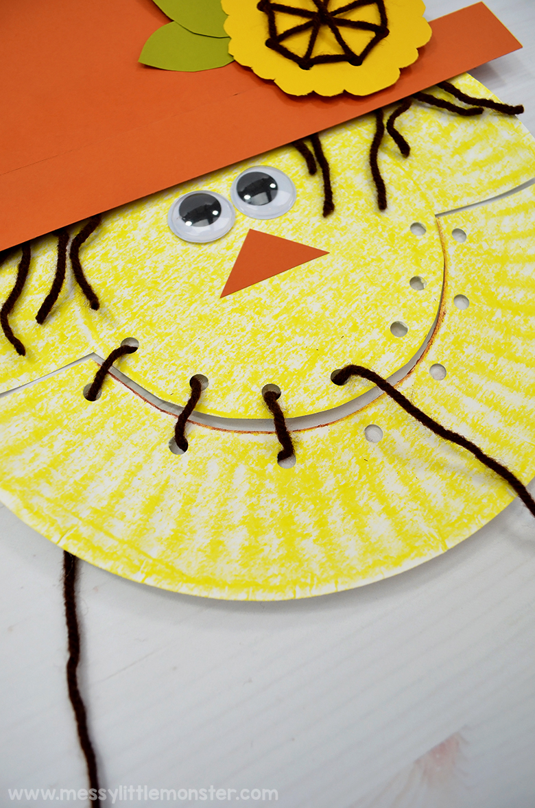 Paper plate scarecrow craft for kids.