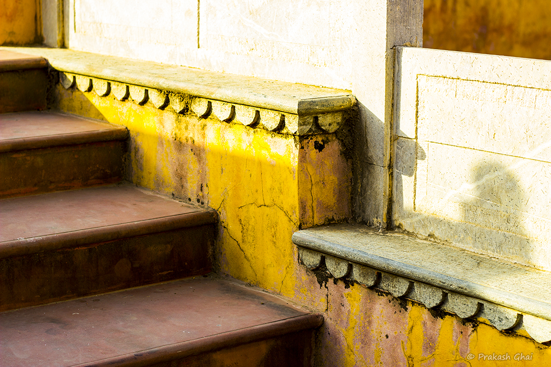 A Minimalist Photo of Steps Leading to a Step Well, Behind Amber Fort Jaipur