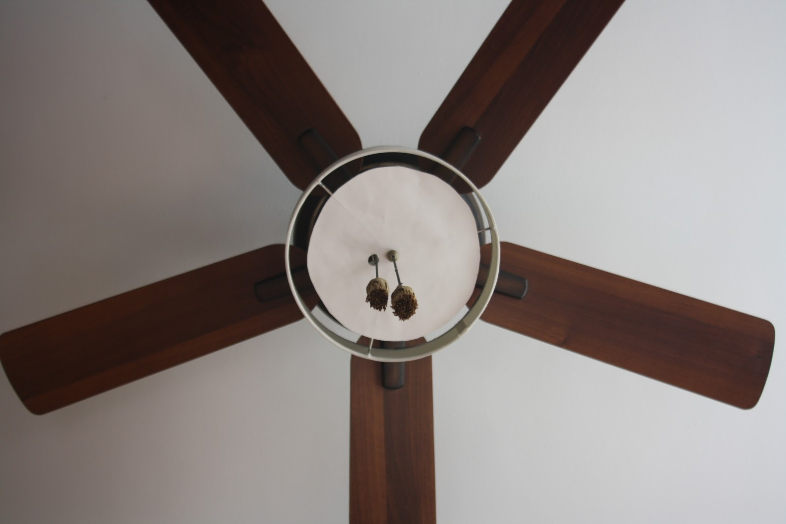 view of the temporary DIY diffuser on the drum shade from below the ceiling fan