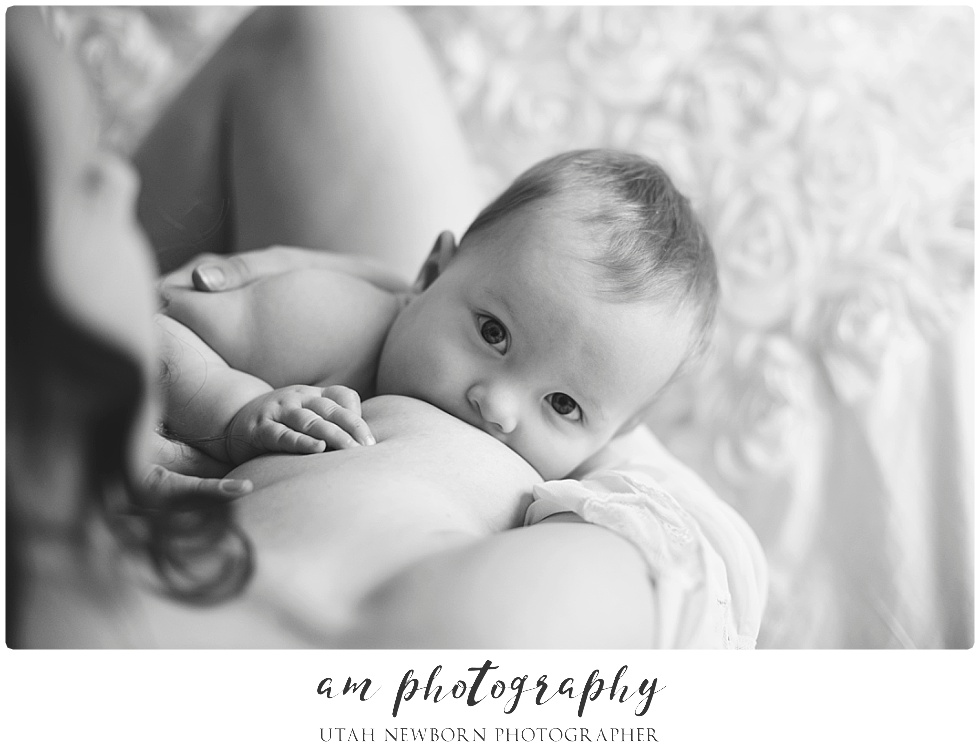 Utah mom breastfeeding baby girl