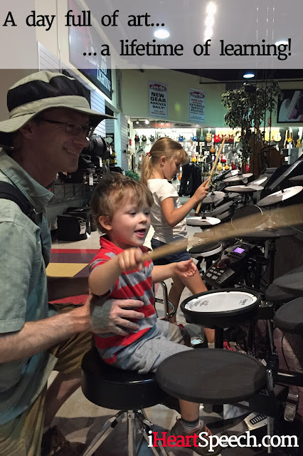 dad teaching son to play drums