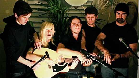 5 people play 1 guitar