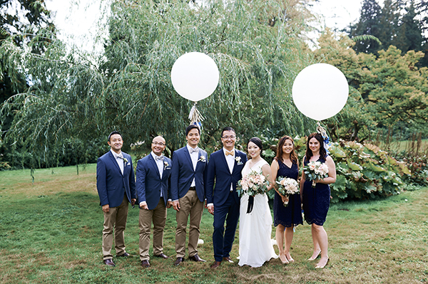 Vancouver beauty, life and style blogger Solo Lisa gets married in her hometown with a ceremony in Stanley Park and a dinner reception at Chambar. Wedding party with a theme of blue and gold.