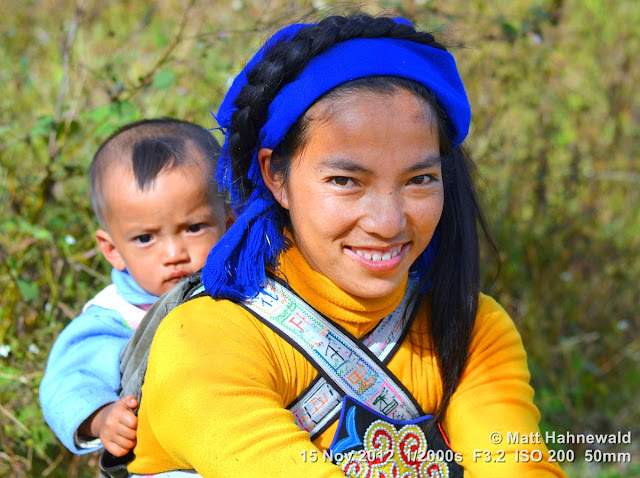 close up; people; street portrait; China; Yunnan; hill tribe; ethnic minority; traditional costume; Yuanyang; Hani people; double portrait; duo portrait