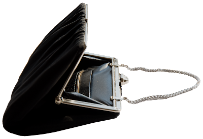 A black evenening bag of silver fittings with black chiffon fabric and black leather inside.