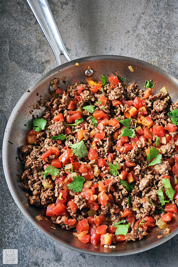 Taco Rice Bowl beef cooked in a skillet with spicy tomatoes