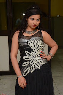Shrisha Dasari in Sleeveless Short Black Dress At Follow Follow U Audio Launch 033.JPG