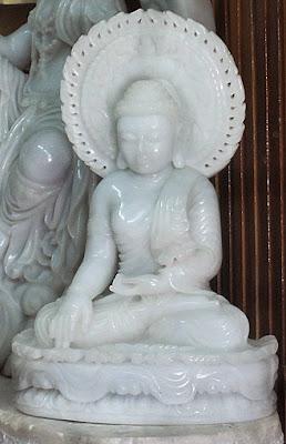 White jade Buddha sitting mudra