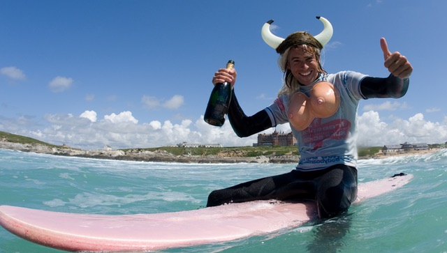 Stag with antlers on and fake boobs on a surf board Newquay
