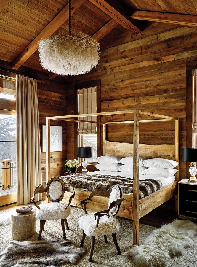 Luxury bedroom with #rusticdecor, wood walls, and fur in a #skihouse by #KenFulk