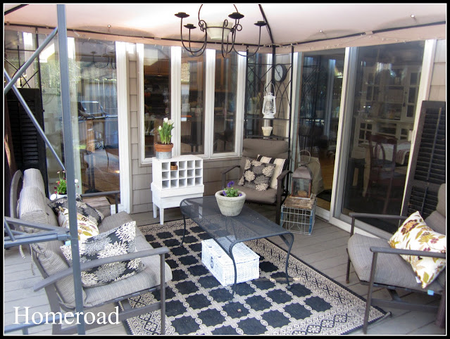 Outdoor deck area filled with furniture