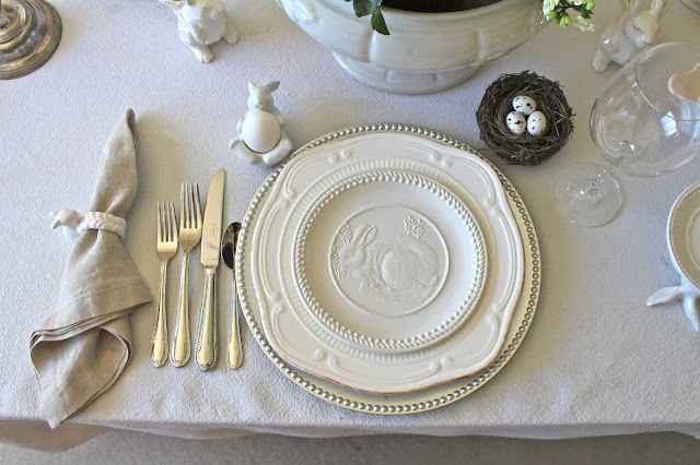 neutral easter tablescape white plates, natural napkins, bunny accessories silver candleholders