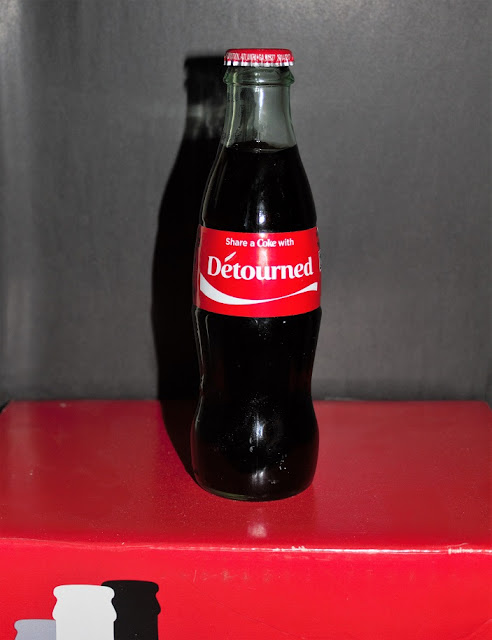 "New Situationist Artwork ""Detourned Coke Bottle on Undetourned Coke Box"""