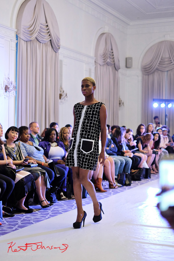 Model on runway wearing a 60s inspired black and white windowpane check dress with patch pockets. André Bryson - Guerrilla - NYFW. Photographed for Street Fashion Sydney by Kent Johnson.