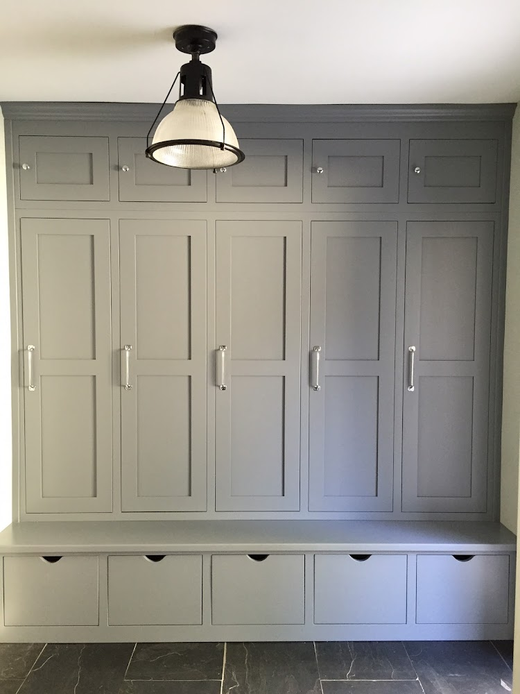 gray built ins mud room