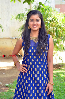 Amritha Pictures in Blue Long Dress at Padaiveeran Tamil Movie Audio Launch