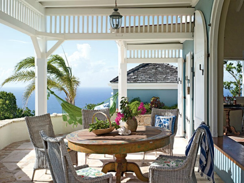 Coastal beach house with a cottage chic outdoor dining area