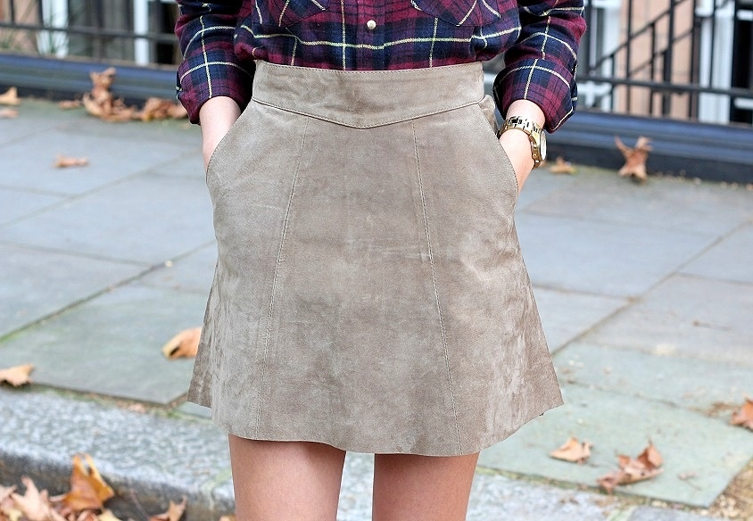 peexo fashion blogger wearing checkered shirt and suede skirt and purple boots