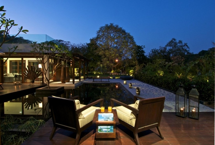 Chairs on terrace of Courtyard Home by Hiren Patel Architects