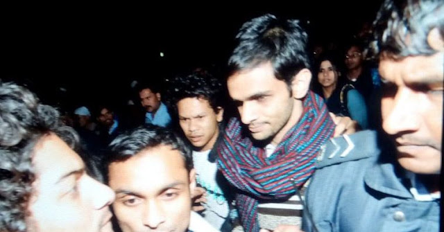 """Arrested JNU students Umar Khalid and Anirban Bhattacharya returned to campus on Friday to a heroes welcome. The duo, who have been accused of sedition,  were released from Tihar jail, after a sessions court gave them bail.  Umar spoke to a large gathering of cheering supporters and said he was proud that they had been booked under provisions that had been used against freedom fighters.  In a 35-minute speech, Umar said he was not ashamed that he had gone to jail. """"Criminals are those who are in power, those in jail are the ones who raise their voice."""" he added."""